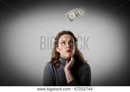 Girl In Grey And One Dollar.