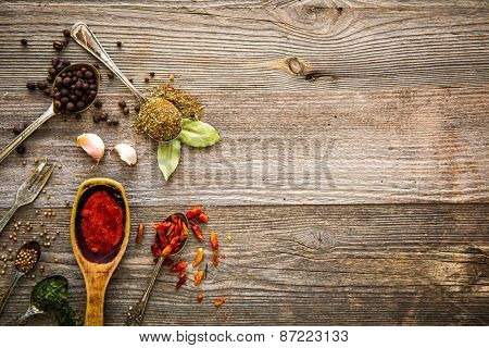 spices and herbs on a brown wooden table