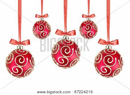Red Christmas Balls With Bows On White Background