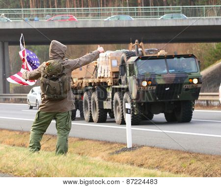 PILSEN CZECH REPUBLIC - APRIL 1, 2015: Unidentified Czech citizens cheering up Dragoon Ride convoy from Operation Atlantic Resolve. Longest march US Army in Europe after second world war.