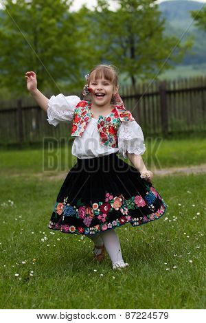 Little Girl In Traditional Costume With Flowers