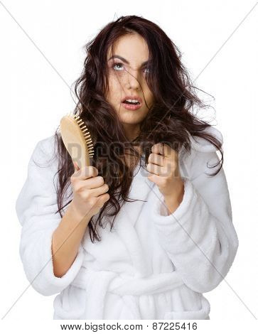 Displeased girl with haircomb isolated