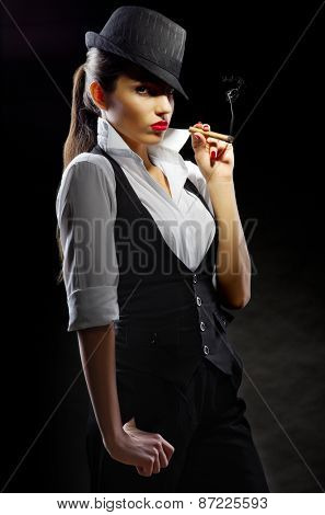 Young woman with cigar on black