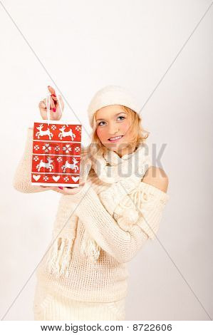 beautiful winter woman ih hat and pullover with chrismas gifts