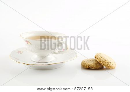 Old-style Vintage Cup Of Tea With Cookies On White Background
