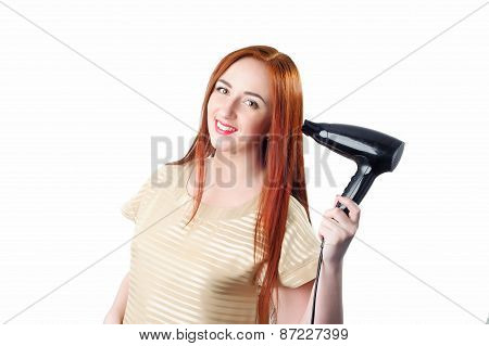 Redhead Woman With Long Hair Holding Hair Dryer