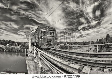 train goes on railway bridge through Volga-don canal. Black and white