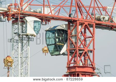 Two Tower Cranes Operator Cabins Facing