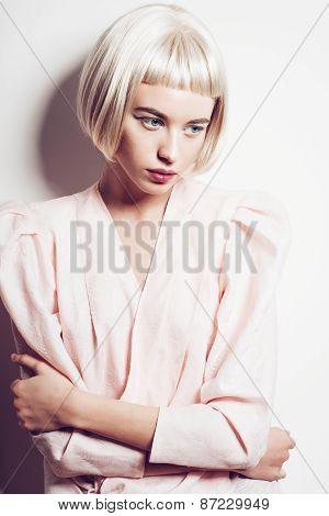Portrait Of A Beautiful Young Blond Woman With Short Hair In The Studio On A White Background