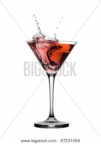 red martini cocktail splashing in glass isolated on white background