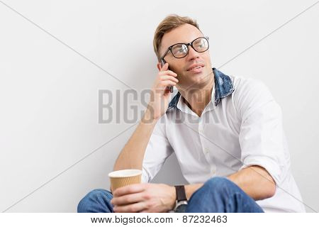 Young hipster talking on phone