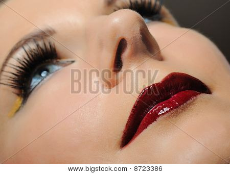 Pretty Woman With Bright Make-up And Violet Lipstick