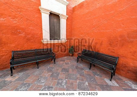 Two Benches In A Monastery