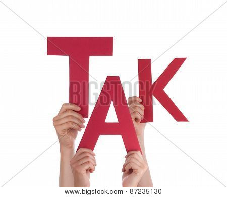 People Holding Danish Word Tak Means Thanks