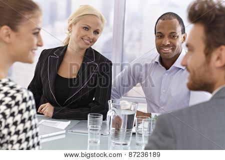 Young partners having businessmeeting, smiling happy.