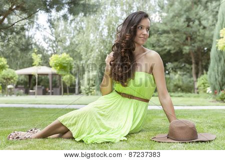 Full length of attractive young woman in sundress at park