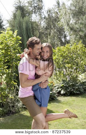 Loving young couple embracing in summer park