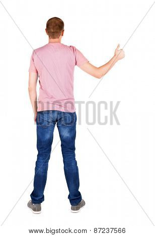 Back view of  man in t-shirt. shows thumbs up.   Rear view people collection.  backside view of person.  Isolated over white background.