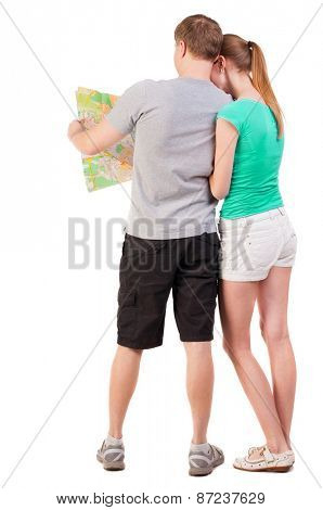Back view journey of the young couple looking at the map. Rear view people collection. husband and wife in a summer vacation  backside view of person.  Isolated over white background.