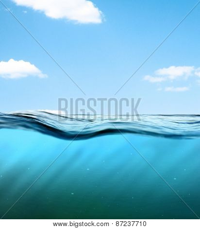 Underwater background. Wave against the sky. Blue ocean landscape