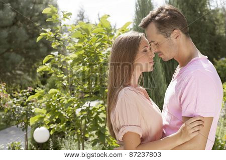 Side view of affectionate young couple in park