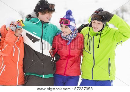Portrait of young friends in warm clothing outdoors