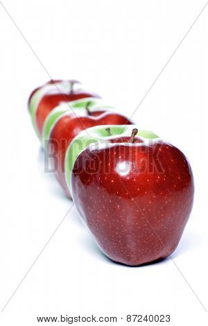 Close-up of apples in row on white background