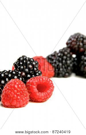Studio shot of raspberries and blackberries