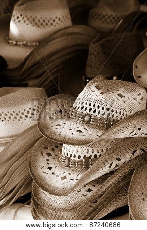 Many Cowboy hats in sepia color tone