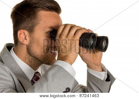 a manager with binoculars looking for jobs or jobs