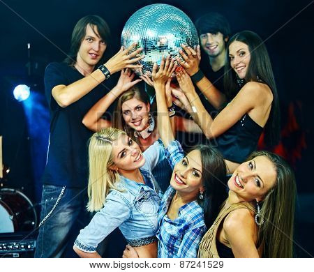 Woman and man on disco in night club taking party ball. Lighting effects.