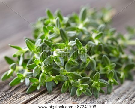 Thyme spice on a wooden background