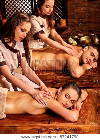 Couple  having oil massage India Ayurveda spa treatment.