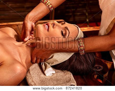 Woman having facial  ayurveda spa treatment. Eyes closed.