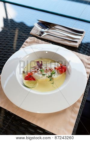 Chilean seabass fillet in plate on restaurant table