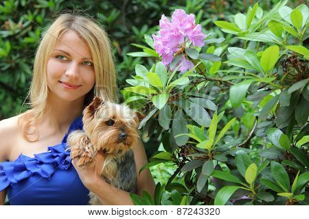 beautiful young woman with dog in park