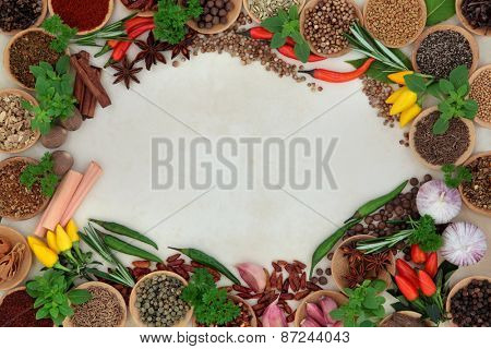 Herb and spice abstract border over parchment background.