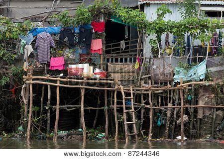 Shanti poor wooden Vietnamese home along the Mekong river in Can Tho city, Vietnam