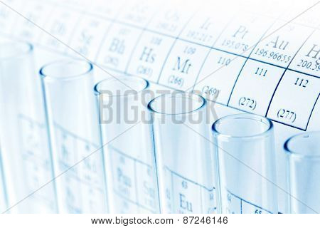 Test tubes and periodic table of elements, science concept