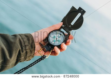 Hiker Searching Direction With A Compass