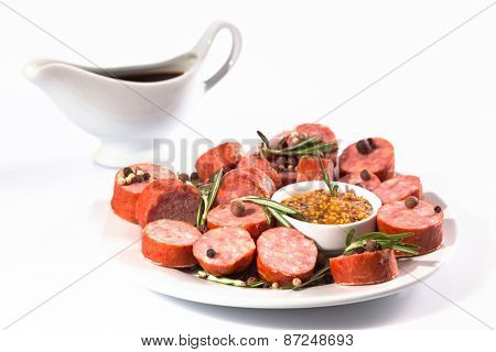 sliced sausage on a white plate
