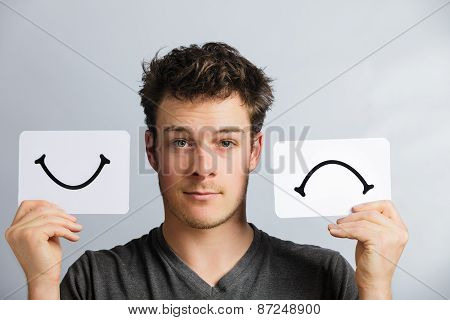 Portrait Of A Person Holding Happy And Unhappy Mood Board