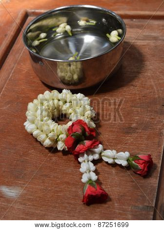 rose garland and jasmine in silver bowl