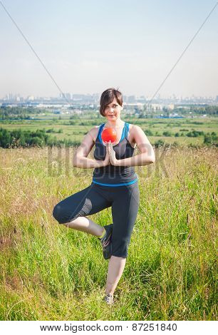 Beautiful Plus Size Woman Exercising With Small Ball