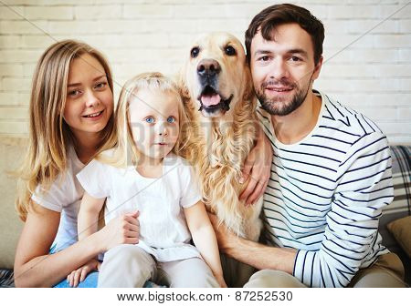 Parents, their daughter and dog spending weekend at home