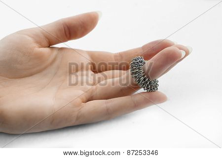 Woman Hand With Massage Ring On A Finger