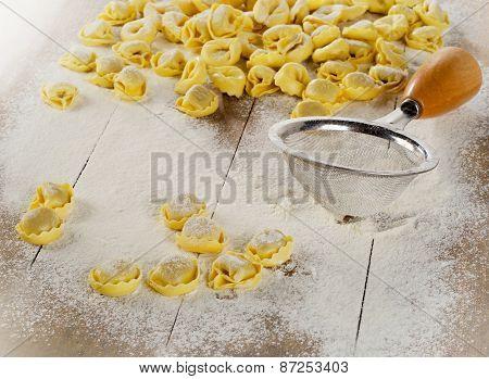 Freshly Made Ravioli Pasta On  Wooden Table