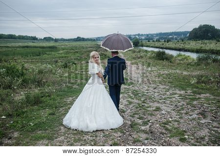 Lovely Couple Having Fun In The Park