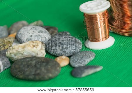 Stones And Copper Wire On A Textile Background