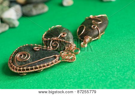 Some Pendents Of Handwork From A Stone And A Copper Wire